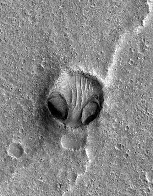 Outrageous Alien Head Carved into Mars Surface, Photo
