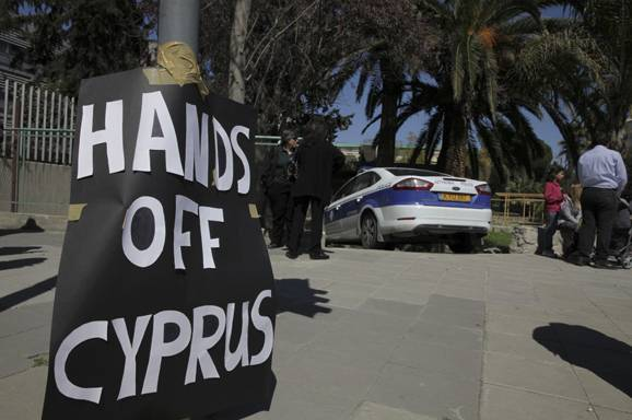 A Safe and a Shotgun or Publicly-owned Banks? The Battle of Cyprus