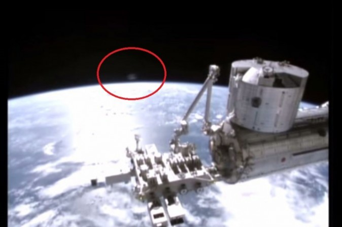 UFO or Satellite? 'Strange Red' Sphere Appears Over Earth on International Space Station Camera