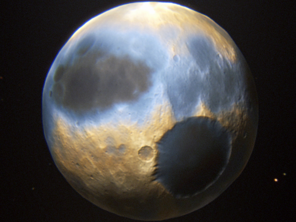 Strange Features on Pluto | S0 News July 12, 2015