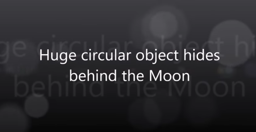 Huge circular object hides behind the Moon [VIDEO]