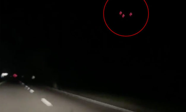 Eerie footage shows black and red 'UFO' hovering over car as terrified driver bursts into tears